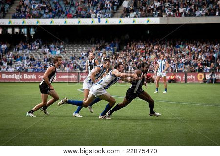 MELBOURNE - APRIL 2:  Collingwood's Harry O'Brien shrugs a tackle in their win over North Melbourne  at Etihad Stadium Docklands - April 2, 2011 in Melbourne, Australia