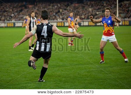 MELBOURNE - AUGUST 20 :  Collingwood's  Alan Didak kicks the ball during their win over Brisbane - August 20, 2011 in Melbourne, Australia.