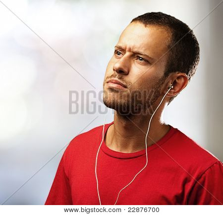 young man listen to music at home