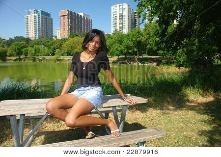 Young Woman on Picnic Table