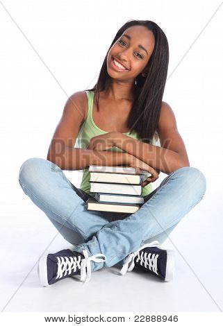 African American Teenage School Girl With Books