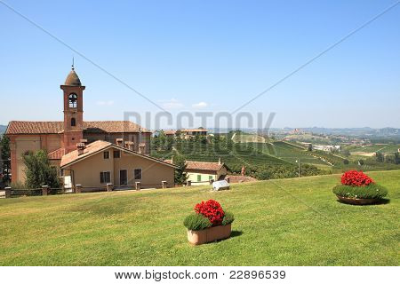 View on old church and green lawn in Grinzane Cavour - small town in northern Italy.