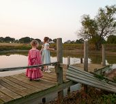 Sisters On A Dock