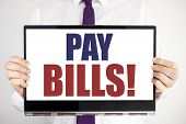 Word, Writing Pay Bills. Business Concept For Finance Paying Online Written On Tablet Laptop Holding poster