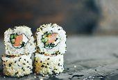Sushi Roll Sushi With Prawn, Avocado, Cream Cheese, Sesame. Sushi Menu. Japanese Food. Concrete Grey poster