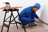 Laborer with screwdriver and blowtorch poster