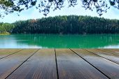 Wooden Boards With Landscape Of Forest Lake. Relaxing Holiday By The Lake. View From Wooden Bridge.  poster