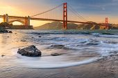 Long Exposure Of A Stunning Sunset At The Beach By The Famous Golden Gate Bridge In San Francisco, C poster