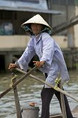 Vietnamese Woman Rowing