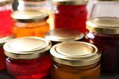 Jars with sweet jams, closeup poster