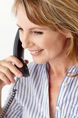 foto of middle-age  - Mid age businesswoman on phone - JPG