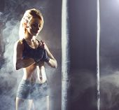 Fit And Sporty Young Woman Having A Muay Thai Training. Girl Training In Undergorund Gym. Health, Sp poster