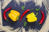 Bitter Pepper With Yellow Pepper On A Black Background. Pasta With Bitter Red Pepper And Yellow Pepp poster