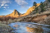Постер, плакат: Eagle Nest Rock and partially frozen North Fork of Cache la Poudre River in northern Colorado at Liv