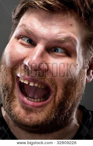 Portrait of crazy man making stupid face
