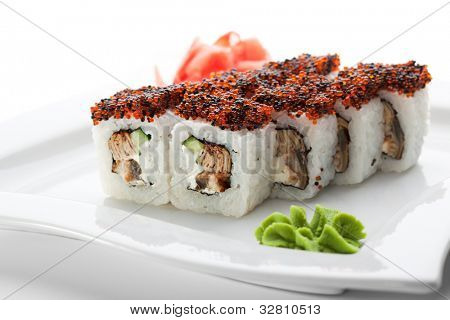 Maki Sushi - Roll made of Cream Cheese, Tamago (japanese omelet), Cucumber and Smoked Eel inside. Topped with Red and Black Tobiko (flying fish roe)