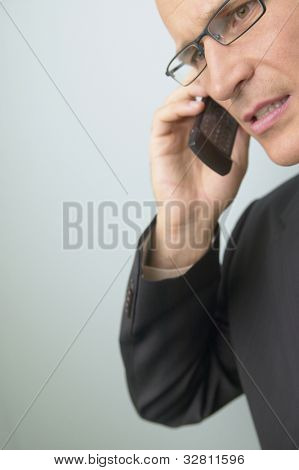 Middle-aged businessman talking on cell phone