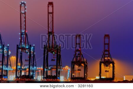Large Quay Cranes With Lighting At Night