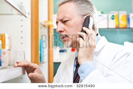 Pharmacist searching for a medicine