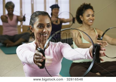 Multi-ethnic women in exercise class