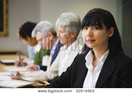 Asian businesswoman at meeting