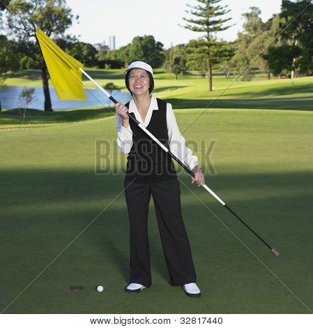 Senior Asian woman on golf course