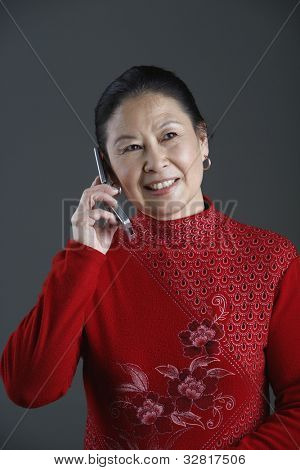 Senior Asian woman talking on cell phone