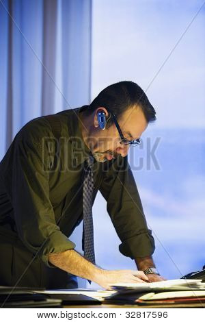 Hispanic businessman reading paperwork