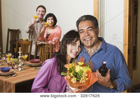 Two middle-aged couples at dinner party