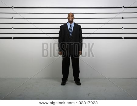 African businessman in police line up