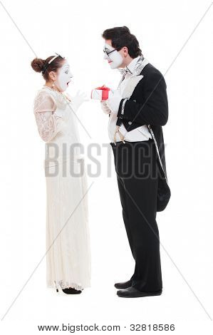 studio shot of funny mimes with present. isolated on white