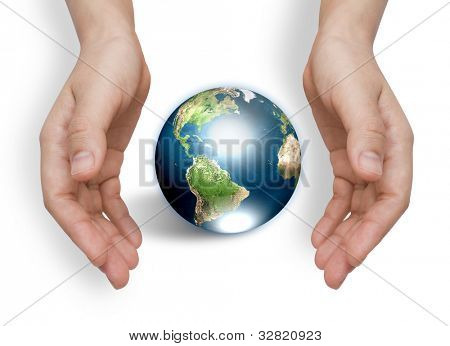 Two hands with earth  (Elements of this image furnished by NASA)