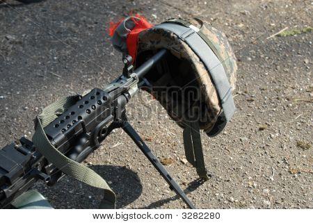 Machine Gun And Helmet