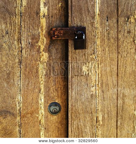 Old Padlock On A Wooden Door