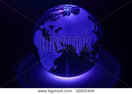 Small glass globe is illuminated by blue light from below; Africa and Eurasia
