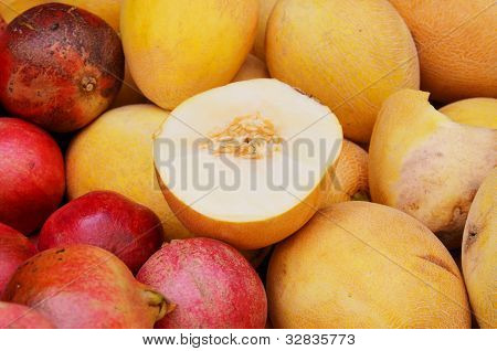 Close Up Of Melons And Pomegranates