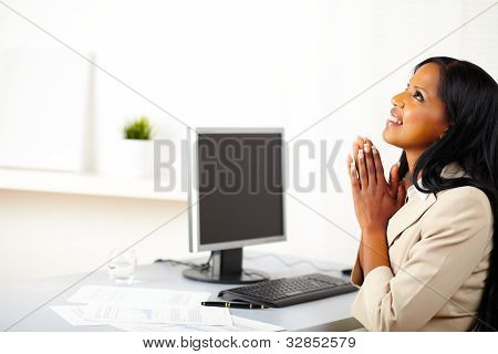 Businesswoman Praying At Work