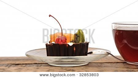 delicious cake with fruit and a cup of tea