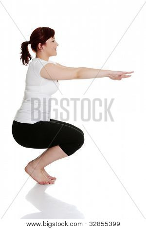 Young woman during fitness time and exercising, isolated on white background