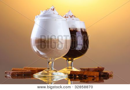glasses of coffee cocktail on brown background