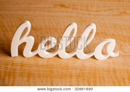 Hello on Wooden Table