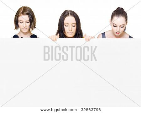 Women Looking Down Holding A Blank Sign