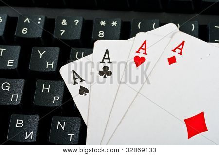 Fragment Of Black Keyboard With Cards.