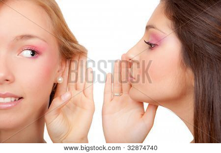 young women or teens whispering secrets scandal or gossip