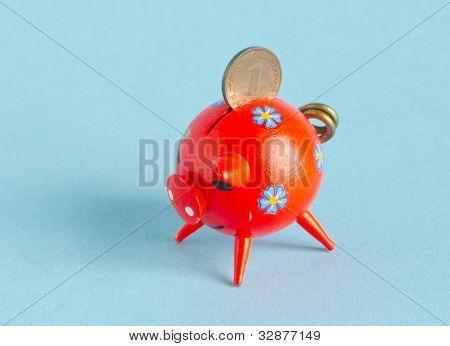 Red Piggybank With Pfennig On Blue Background
