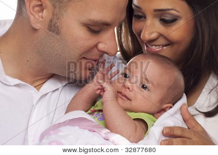 Happy Young Attractive Mixed Race Couple with Newborn Baby.