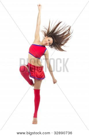 Dancer From Cheerleading Team Dancing And Jumping
