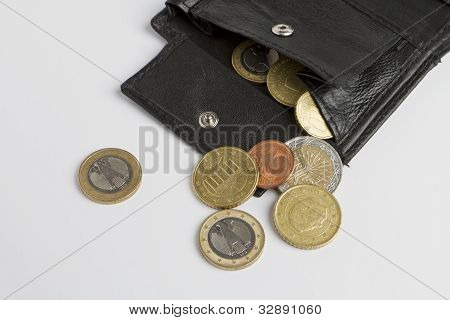 Loose Cash Falling Out Of Black Wallet