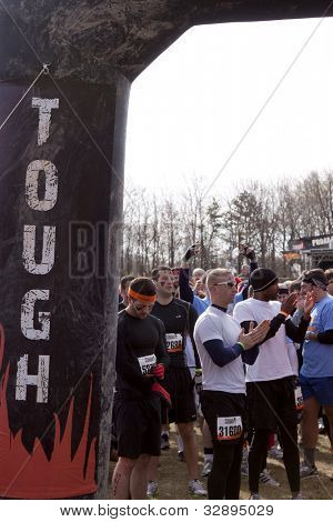 POCONO MANOR, PA - APR 29: Participants gather at the starting line to prepare at Tough Mudder on April 29, 2012 in Pocono Manor, Pennsylvania. The course is designed by British Royal troops.