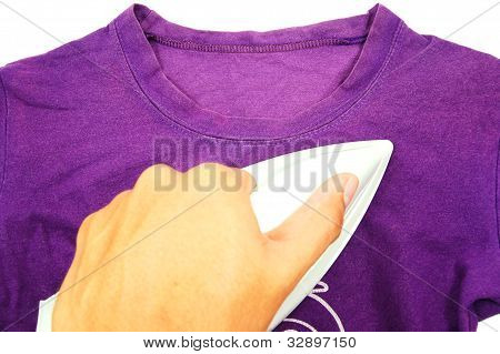 hand was ironing purple cloth